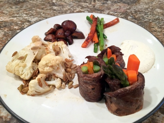 Balsamic skirt steak roll-ups, cauliflower with sunflower and pumpkin seeds, and balsamic mushrooms. Extra carrots and asparagus on the side.